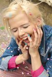 Multi-colored confetti and colorful manicure Royalty Free Stock Image