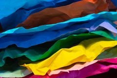 Multi-colored crumpled sheets of paper stock photos