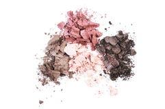 Multi colored crushed eyeshadows isolated on white background Stock Photography