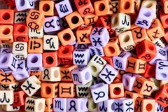 Multi-colored cubes with zodiac signs close-up stock photography
