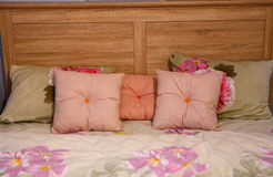 Multi-colored cushions lie on the bed Royalty Free Stock Images