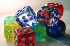 Multi-colored dice. Glowing multi-colored dice stock image