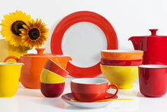Multi colored Dishware. Summer Multi colored Dishware with Sunflower stock image
