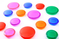 Multi-Colored disks on white background Stock Images