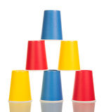 Multi-colored disposable paper cups isolated on white. Stock Photo