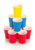 Multi-colored disposable paper cups isolated on white. Stock Photos