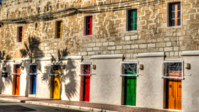Multi-colored doors and windows in the facade in Marsaxlokk Royalty Free Stock Photography