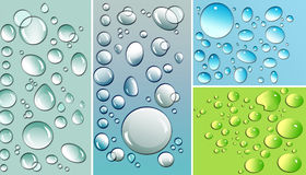 Multi-colored droplets with colored backgrounds Royalty Free Stock Photography