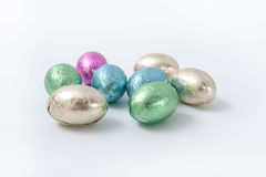 Multi-colored easter chocolate eggs in colored foil Stock Photos