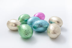 Multi-colored easter chocolate eggs in colored foil Stock Photo