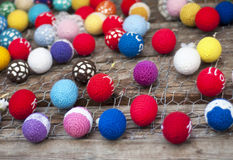 Multi-colored easter eggs. Decorative multi-colored easter eggs hanging on a wooden background wall. Selective focus, shallow FOF Royalty Free Stock Photo