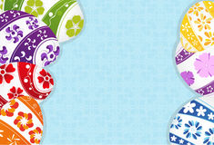 Multi-colored Easter eggs background. Easter eggs with floral pattern on a blue background royalty free illustration