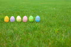 Multi-colored Easter eggs on green grass Royalty Free Stock Photo