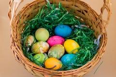 Multi colored Easter eggs in green plastic grass Stock Photo