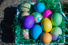 Multi colored Easter eggs in green plastic grass stock photography