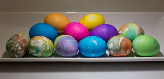Multi colored Easter eggs in green plastic grass stock image