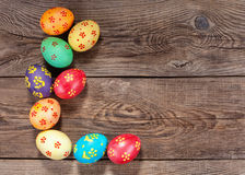 Multi-colored Easter eggs on the old board Stock Image