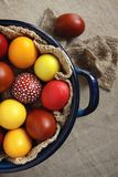 Multi-colored Easter eggs in a pot. In Ukraine Stock Photos