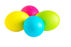 Multi-colored Easter eggs on the white background. Four colored Easter eggs on the white background stock photography