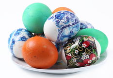 Multi-colored eggs on a plate. Stock Photography