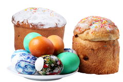 Multi-colored eggs on a plate and cakes. Royalty Free Stock Photography