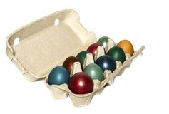 Multi-colored eggs in a tray on a white background royalty free stock image