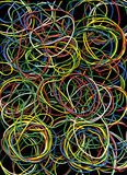 Multi-colored elastic bands. Background from many multi-colored writing elastic bands Stock Photo