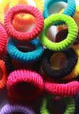 Multi colored elastic hair bands with side lighting. Stock Images