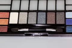 Multi colored eye shadow palette on the counter waiting to be used royalty free stock photos