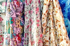 Multi-colored fabric scarves. Close-up, selective focus royalty free stock photos