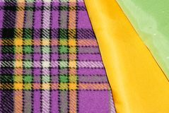 Multi-colored fabrics for sewing. Colourful checkered fabric for sewing Royalty Free Stock Photos