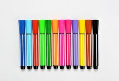 Multi colored felt tip pens on white background. Multi colored felt tip pens isolated on white stock image