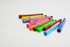 Multi colored felt tip pens on white background. Multi colored felt tip pens isolated on white stock images