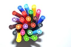 Multi-colored felt-tip pens on the white isolated background. Top view. Selective focus Royalty Free Stock Photography