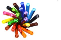 Multi-colored felt-tip pens on the white isolated background. Top view. Selective focus Royalty Free Stock Photo
