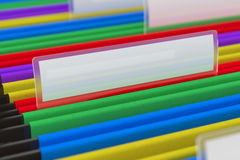 Multi colored File Folders. Multi colored hanging folder with blank tag on it Stock Images