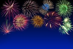 Multi-colored fireworks on dark blue royalty free stock images