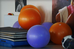 Multi-colored fitballs in the gym for aerobics stock photos