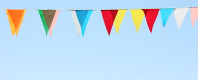 Multi-colored flags on a blue sky background Royalty Free Stock Photo