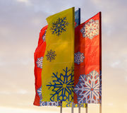 Multi-colored flags, with painted snowflakes Royalty Free Stock Image
