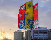 Multi-colored flags, with painted snowflakes in Stock Images
