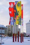 Multi-colored flags, with painted snowflakes in Stock Photography