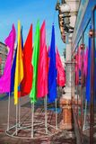 Multi-colored flags on the street. Multicolored flags on city streets Royalty Free Stock Image