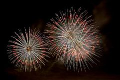 Multi-colored flashes of festive salute fireworks Stock Photos