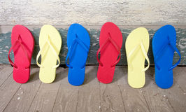 Multi Colored Flip-Flops On The Porch Royalty Free Stock Images