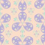 Multi colored floral seamless pattern. Beige background with violet and blue flower elements. For wallpapers, textile and fabrics Royalty Free Stock Images