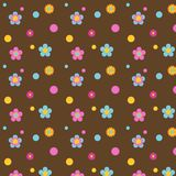 Multi Colored Flowers on Brown. Multi colored flowers and polka dots on a background of brown for scrapbooking, card making, stationery or crafting Royalty Free Stock Image