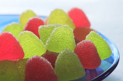 Multi-colored fruit candy. Colored fruit candy on a blue plate Stock Photography