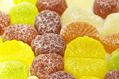 Multi-colored fruit candy sprinkled with sugar. royalty free stock image