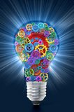 Multi colored gears in motion inside lightbulb. 3D illustration.  Royalty Free Illustration